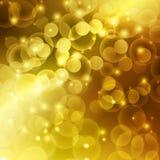 Fundo da luz do sumário do bokeh da cor do ouro Ilustração Stock