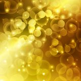 Fundo da luz do sumário do bokeh da cor do ouro Fotografia de Stock Royalty Free