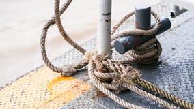 Fundo da onda do rio do barco da segurança do nó da corda Imagens de Stock Royalty Free