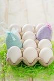 Fundo da Páscoa com os ovos coloridos pasteis Fotografia de Stock
