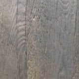 Fundo da pedra com uma textura do woodgrain A textura do relevo da pedra é áspera imagens de stock