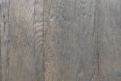 Fundo da pedra com uma textura do woodgrain A textura do relevo da pedra é áspera fotografia de stock royalty free