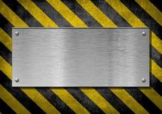 Fundo da placa de metal com listras do perigo imagem de stock