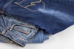Fundo da sarja de Nimes, sarja de Nimes com uma emenda do projeto elegante roupa trousers imagens de stock