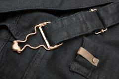 Fundo da sarja de Nimes preta com elementos e as emendas de cobre imagens de stock