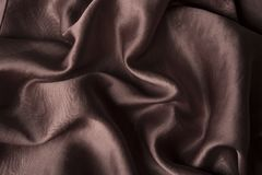 Fundo da seda do chocolate de Brown O pano liso acena a textura do fundo cor da forma fotografia de stock royalty free
