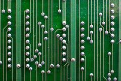 Fundo da tecnologia da eletrônica no verde Fotografia de Stock