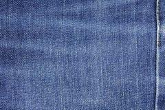 Fundo da textura da tela das calças de brim da sarja de Nimes com a emenda para o projeto Imagens de Stock