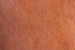 Fundo da textura do marrom do couro sintético do close up Couro abstrato v Imagem de Stock