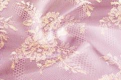 Fundo da textura da imagem, laço decorativo do ouro com teste padrão Gol Foto de Stock