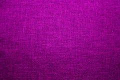 Fundo da textura da tela, matéria têxtil, violeta, peça da roupa, foto de stock