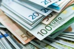 Fundo das cédulas do dinheiro do Euro e do dólar dos EUA Imagens de Stock