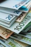 Fundo das cédulas do dinheiro do Euro e do dólar dos EUA Foto de Stock Royalty Free