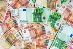 Fundo das cédulas do russo e do Euro Imagens de Stock