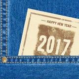 Fundo das calças de brim do ano novo feliz 2017 Imagem de Stock Royalty Free