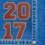 Fundo das calças de brim do ano novo feliz 2017 Fotografia de Stock Royalty Free