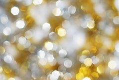 Fundo das luzes da prata e do ouro Fotos de Stock