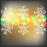 Fundo das luzes e dos flocos de neve de Natal Imagens de Stock Royalty Free