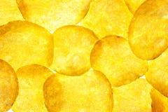 Fundo das microplaquetas de batata/batatas fritas/macro Foto de Stock