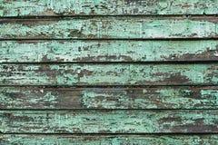 Fundo das placas de madeira velhas pintadas com pintura de água-marinha Imagem de Stock