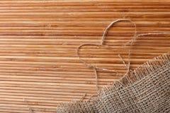 Fundo de bambu com coração Imagem de Stock