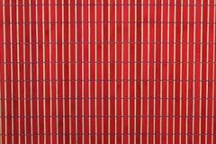 Fundo de bambu vermelho e de madeira Foto de Stock Royalty Free
