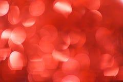 Fundo de Bokeh do Natal: Vermelho Imagem conservada em estoque Fotos de Stock Royalty Free