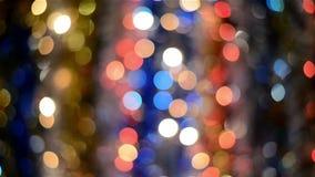Fundo de Bokeh, fora das luzes do foco, de sumário defocused do Natal e do ano novo feliz video estoque