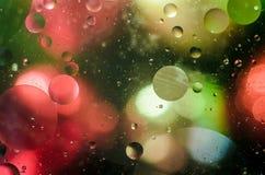Fundo de círculos coloridos brilhantes, um tiro do close-up imagens de stock