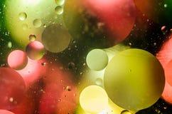 Fundo de círculos coloridos brilhantes, um tiro do close-up imagem de stock