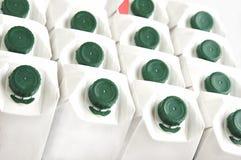 Fundo de caixas do leite. imagem de stock royalty free