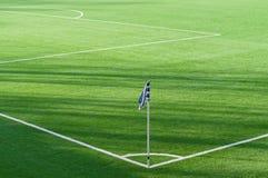 Fundo de canto da marcação da bandeira no campo de futebol Fotos de Stock Royalty Free