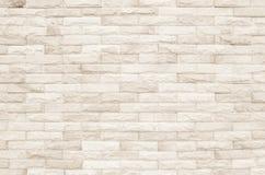 Fundo de creme e branco da textura da parede de tijolo Alvenaria ou ston imagem de stock
