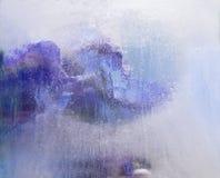 Fundo de   flor do delfínio congelada no gelo fotografia de stock royalty free