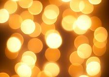 Fundo de incandescência brilhante das luzes amarelas Imagens de Stock