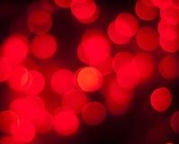 Fundo de incandescência brilhante das luzes vermelhas Imagem de Stock