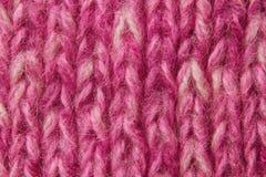 Fundo de lã da textura, tela feita malha de lãs, fluff peludo do rosa Imagens de Stock