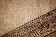 Fundo de linho com textura e a vinheta de madeira da prancha Foto de Stock