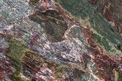 Fundo de mármore natural com uma textura áspera da pedra com dif Imagens de Stock Royalty Free