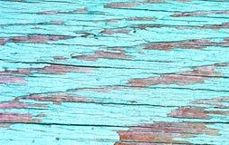 Fundo de madeira áspero pintado, contexto velho com turquesa rachada da pintura imagem de stock