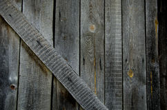 Fundo de madeira cinzento velho do fragmento da porta Foto de Stock
