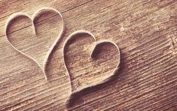 Fundo de madeira com corações Foto de Stock