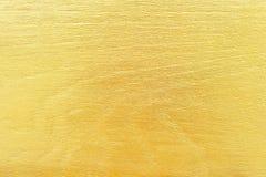 Fundo de madeira da textura dos testes padrões da parede das ondas do ouro fotos de stock royalty free