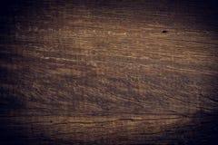 Fundo de madeira escuro, superfície áspera da grão da placa de madeira Imagens de Stock Royalty Free