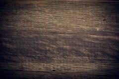 Fundo de madeira escuro, textura áspera da superfície da grão da placa de madeira Fotografia de Stock