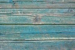 Fundo de madeira velho da prancha pintada em ciano imagem de stock