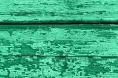 Fundo de madeira velho das placas com pintura rachada e da casca Cor neo da hortelã fotografia de stock