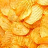 Fundo de microplaquetas douradas friáveis com textura com nervuras, temperado, Imagem de Stock