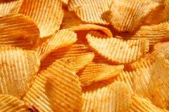 Fundo de microplaquetas douradas friáveis com textura com nervuras, temperado, Imagens de Stock