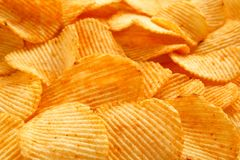 Fundo de microplaquetas douradas friáveis com textura com nervuras, temperado, Imagem de Stock Royalty Free